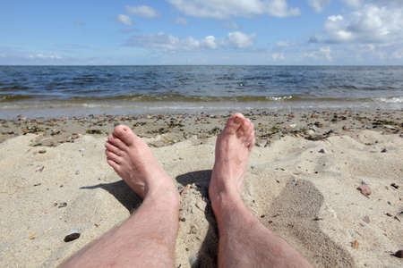 man legs: man s legs on the beach - first person perspective
