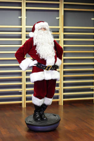 Santa Claus Fitness training on stablity hemisphere photo