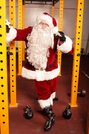 Santa Claus physical condition before Christmas training in gym photo