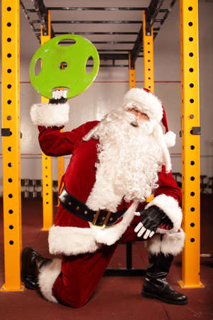 Santa Claus physical condition training before Christams time in gym photo