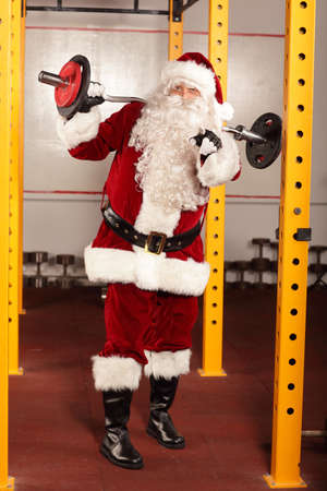 knee bend: Santa Claus physical condition training before Christams time in gym