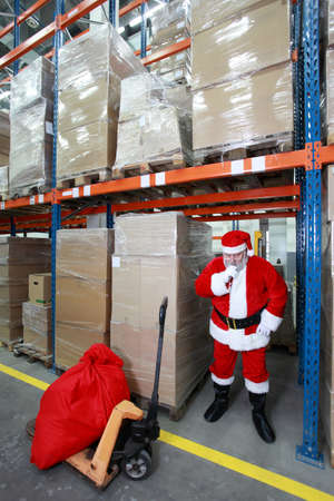 having break -thinking santa claus in storehouse photo