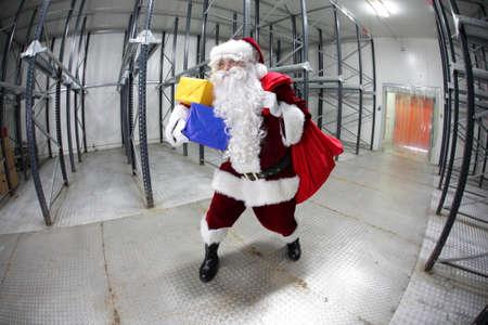 commercialization:  Last minute Santa Claus leaving empty storehouse