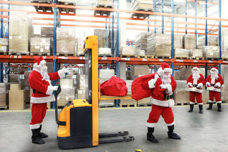 commercialization: santa clauses in the line for the sacks of gifts in storehouse