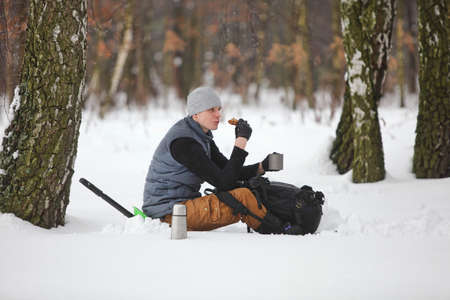 winter hiker having break for sandwich and cup of tea Stock Photo - 24034833