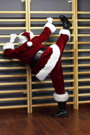 wall bars: Santa claus exercising with wall bars,Christmas Time preparation