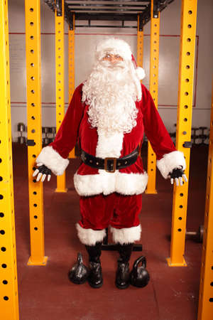 Santa Claus  before Christmas training in gym - portrait photo