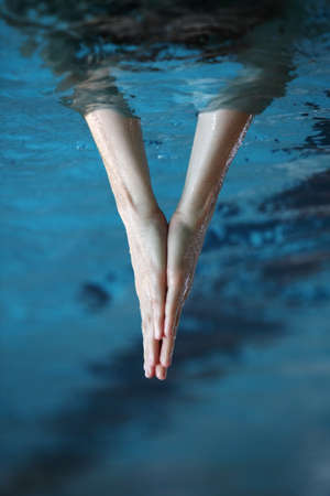 body dimensions: two hands together surfaced from water, V - shape sign