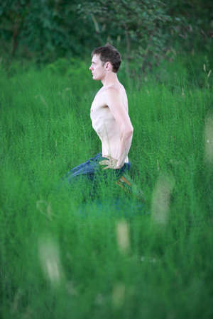 Meditation - topless  man practicing breathing technique - profile photo