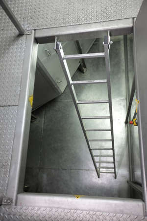 metal ladder in high tech stainless steel industrial space photo