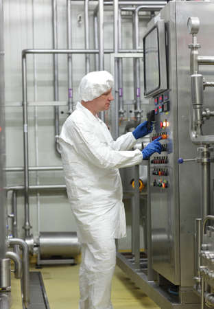 biotechnology technician controlling industrial process Stock Photo