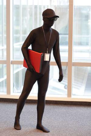 professional anonymous hacker with laptop portrait photo