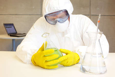 technician in protective uniform working  in lab photo