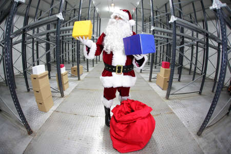 commercialization: Santa Claus preparing for Christmas in storehouse Stock Photo