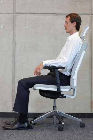 positions: business man on chair in correct sitting position - resting
