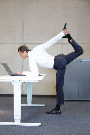 operative system: Business man v3.0 - Young fit ,corporate warrior as a healthy life icon at work Stock Photo
