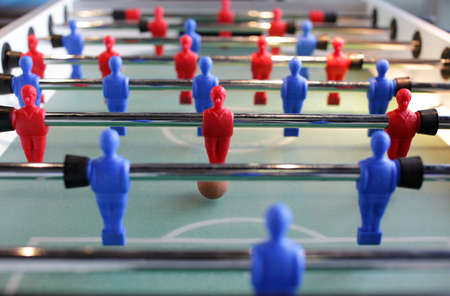 attacker: Table football,table soccer,foosball,kicker - attacker in focus Stock Photo