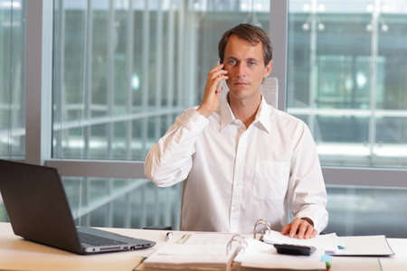 caucasian white: white collar worker caucasian male on phone in his office Stock Photo