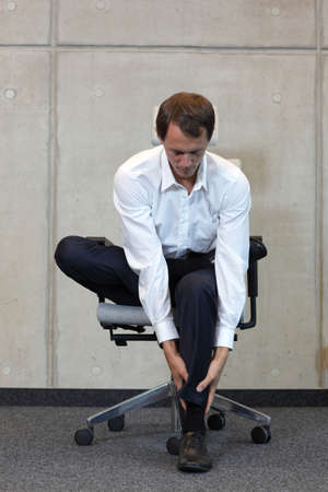 chairs: office occupational disease prevention - business man exercising on chair