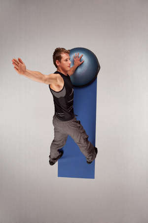 centering: Overhead view of man practicing pilates Stock Photo