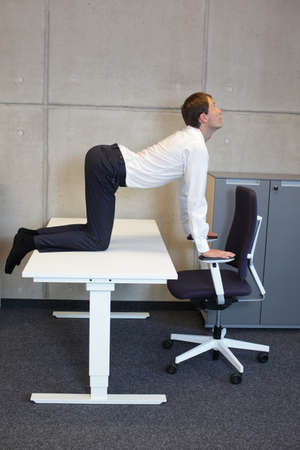 bends: yoga in office. business man exercising at workplace