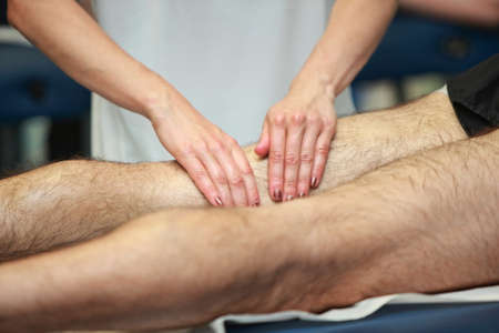 treat acupressure: hands massaging athletes thigh after running