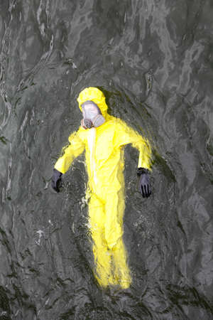 protective: technician  in protective suit in dark water