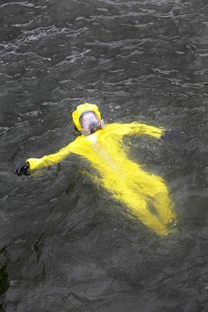 protective suit: technician  in protective suit in dark water