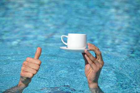 disclose: recommendation - all inclusive,thumb up gesture - hand above water holding cup of coffee