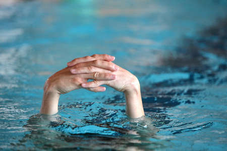 diving save: two folded hands above water  - body language