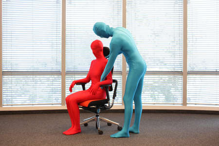 skintight: correct sitting position on office armchair training Stock Photo