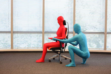 manequin: correct sitting position on office armchair training  - demonstration