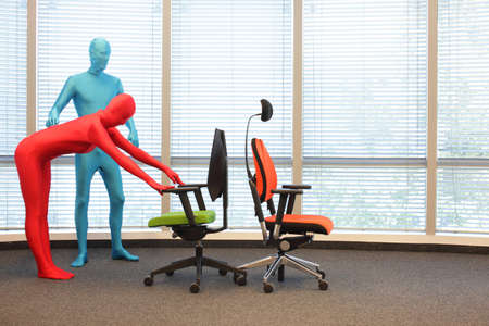 skintight: anonymous people posture training  at chairs  in the office