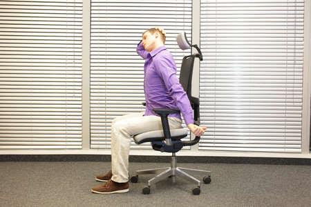 relieving pain: white collar worker male relaxing neck - demonstration - short break for exercise in office