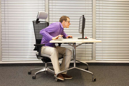 myopia: Near-sightedness,  myopia. Office worker at work station