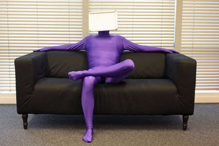 faceless relaxed  man  with blank whiteboard  - messenger -  sitting on sofa in office - waiting