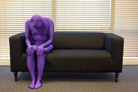 needless: depression -  anonymous, crooked,lonely,man sitting on sofa in office,