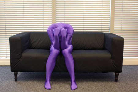 couch: depression - anonymous, crooked,lonely ,man sitting on sofa
