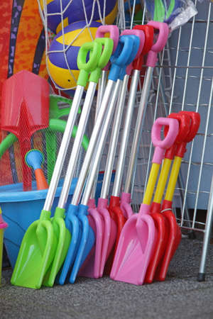 close up: essential beach plastic tools for kids in outdoor shop - close up