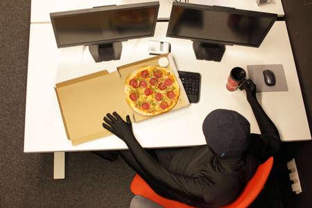 fast meal: hacker heaving break for pizza - fast meal in office