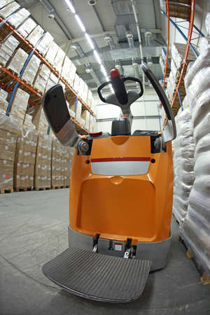 store shelf: forklift loader  in storehouse Stock Photo