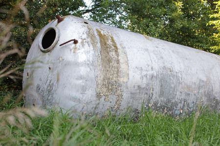 stainless: abandoned large stainless steel industrial tank