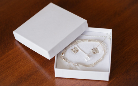silver necklace in white box for the bride Stock Photo