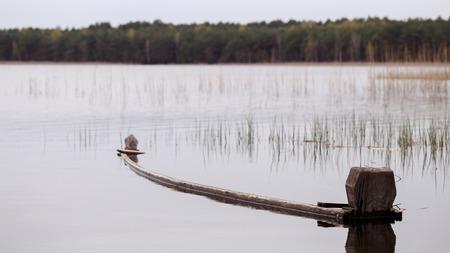 submerged boat on a lake