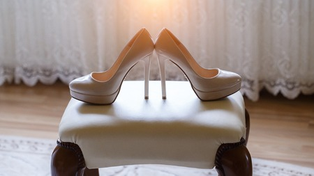 beautiful white bridal shoes with heels for the bride Stock Photo