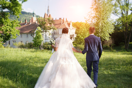 wedding couple walking in a beautiful park in summer Stock Photo