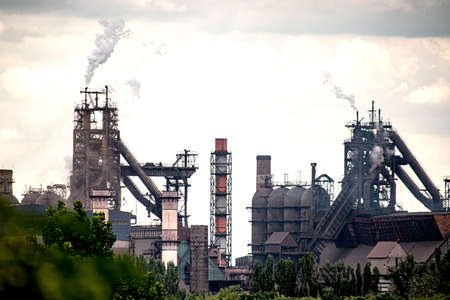 The metallurgical plant pollutes the environment and the atmosphere with its emissions.