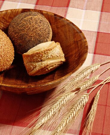 assorted bread on wood basket over a table photo