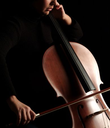 cellist: Close up of a cello player Stock Photo