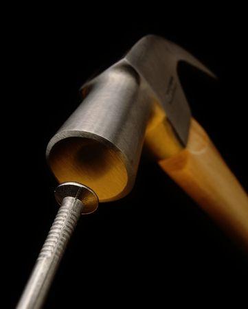 striking: Hammer striking a nail Stock Photo